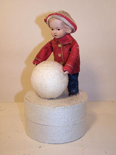 MEG BUILDS A SNOWMAN
