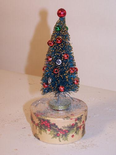 DECORATED BOTTLE BRUSH TREE ON GIFT BOX