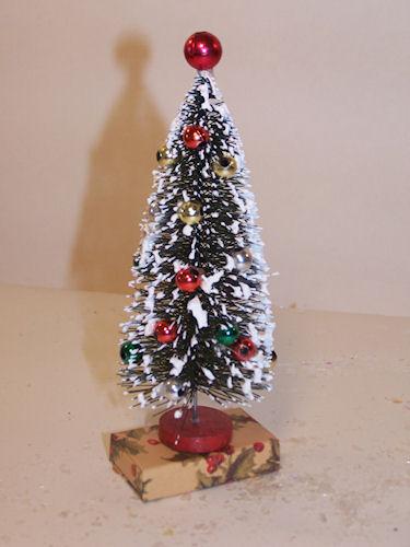 DECORATED BOTTLE BRUSH TREE ON RECTANGULAR BOX